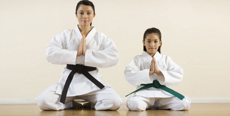 master and student kneeling