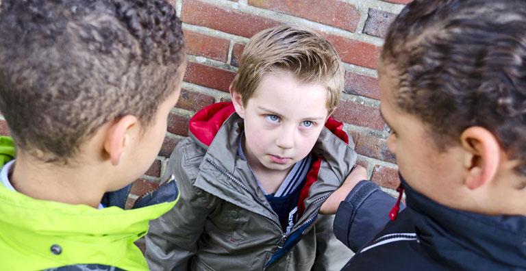 kids bullying a victim